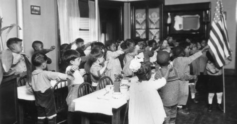 1939:  Children reciting the pledge of allegiance in an Elementary School classroom in Los Angeles, California.  (Photo by MPI/Getty Images)